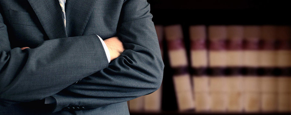 paralegal covered under Errors and omissions standing arms crossed