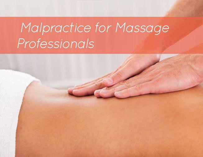 a massage therapist giving a client a back massage