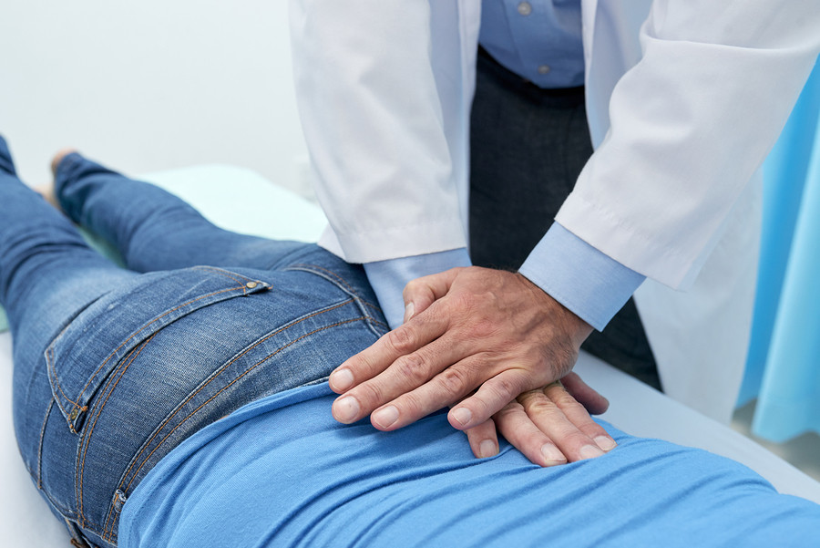 chiropractor fixing patients back after soccer injury