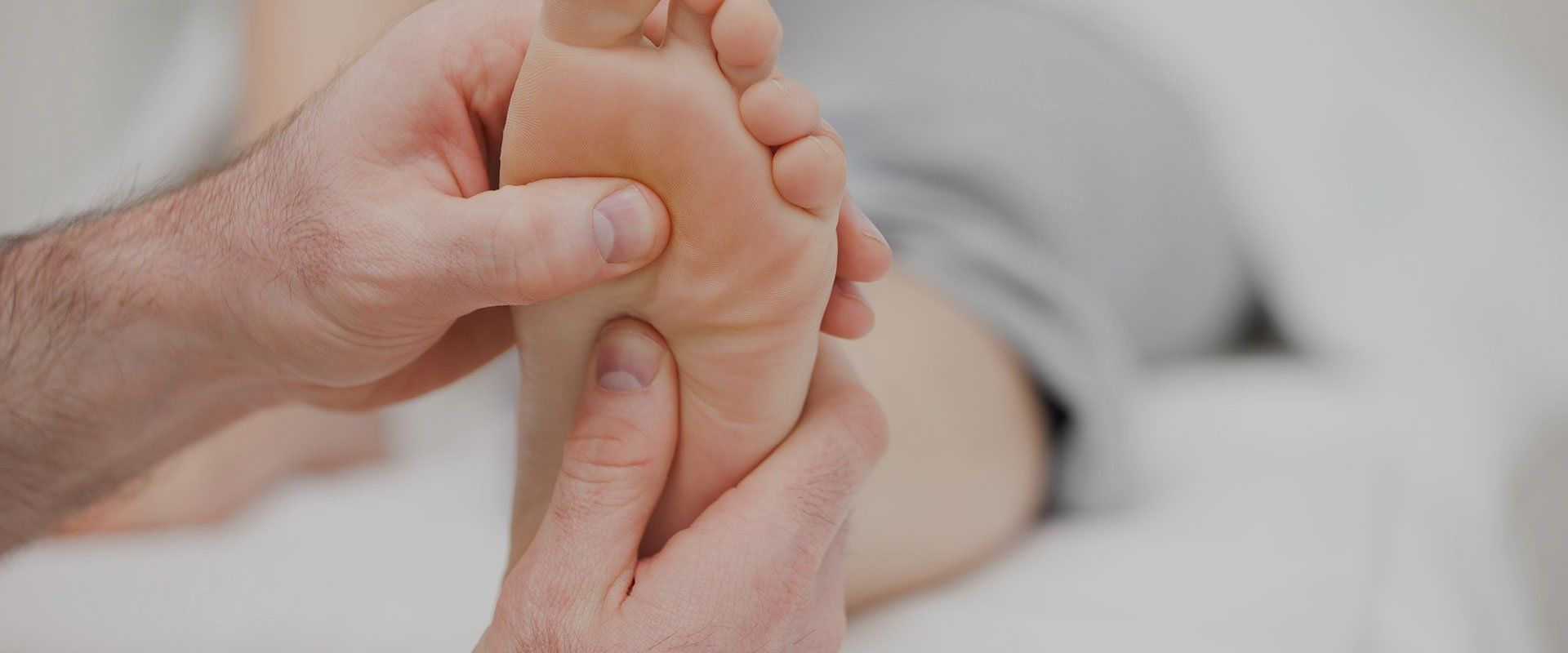 foot doctor checking patient foot because of painful symptoms