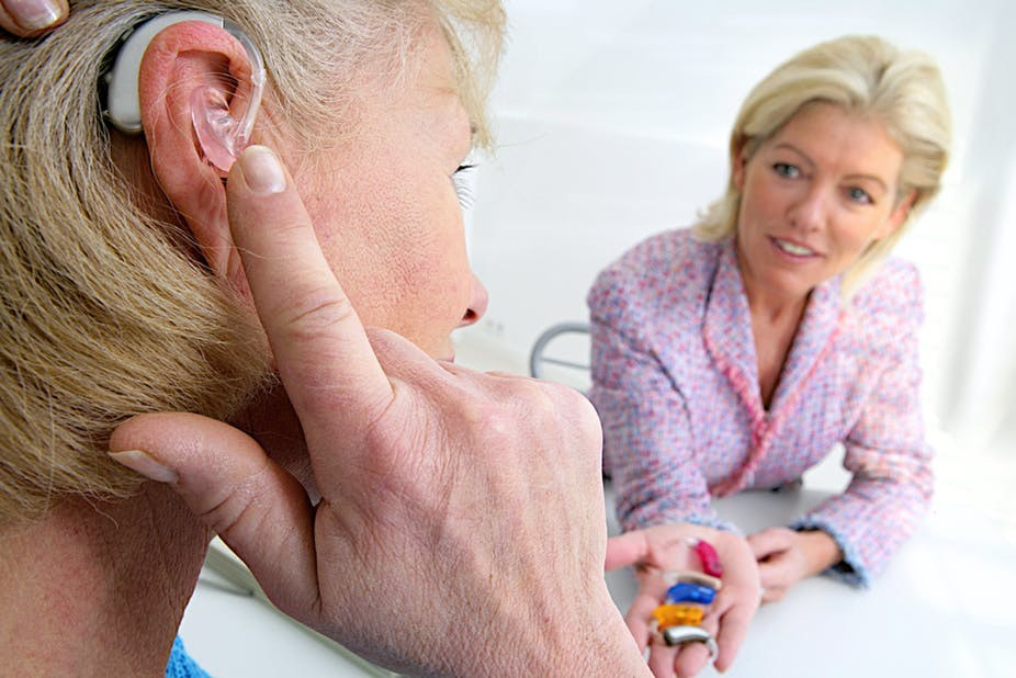 patient trying out new hearing aid